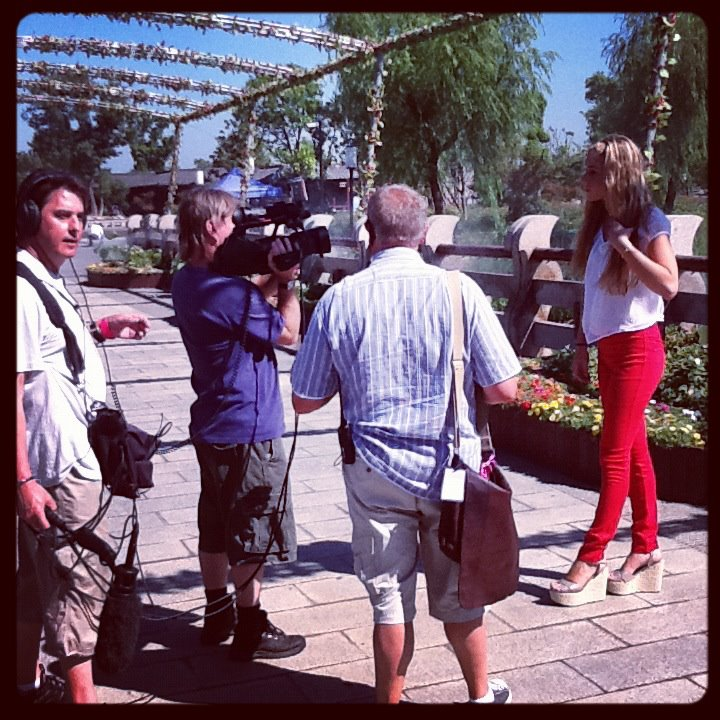 on set, filming with the Miss World crew